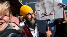 NDP leader Jagmeet Singh poses for photographs during a campaign stop in Toronto on Tuesday, October 15, 2019. THE CANADIAN PRESS/Nathan Denette
