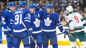 Toronto Maple Leafs Mitchell Marner (16) celebrates after scoring his team's second goal with teammates Morgan Rielly (44), John Tavares (91) and Andreas Johnsson (18) during second period NHL hockey action against the Minnesota Wild, in Toronto, Tuesday, Oct. 15, 2019. THE CANADIAN PRESS/Chris Young