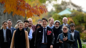 Liberal leader Justin Trudeau walks with Liberal candidates during a campaign stop at the Botanical Garden in Montreal on Wednesday Oct. 16, 2019. THE CANADIAN PRESS/Sean Kilpatrick