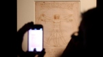 "FILE - In this Tuesday April 14, 2015 file photo, Leonardo da Vinci's ""Vitruvian Man"" is displayed during an exhibition in Milan, Italy. An Italian court has ruled that Leonardo Da Vinci's iconic Vitruvian Man drawing can be loaned to France's Louvre, solving a long-going cultural dispute between Italy and France. The Venice court last week had suspended the loan of the world-famous drawing, which is part of a batch of works by Leonardo and Raphael that the Italian government had agreed to send to Paris. Wednesday's ruling cleared the way to the loan, rejecting a complaint filed by an Italian heritage group, Italia Nostra (Our Italy), which contended that the drawing was too fragile to travel and risked being damaged. (Matteo Bazzi/ANSA via AP) The Associated Press"