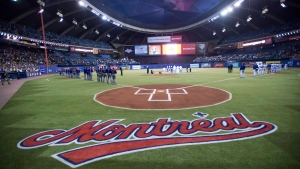 Teams stand on the base lines during the national anthem prior to a pre-season game between the Toronto Blue Jays and the New York Mets Friday, March 28, 2014 in Montreal. The Toronto Blue Jays will return to Montreal to play two pre-season games for the seventh consecutive season next year. THE CANADIAN PRESS/Paul Chiasson