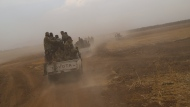 A convoy of Turkish backed Free Syria Army is about to cross into Turkey near the town of Azaz, Syria, Wednesday, Oct. 16, 2019. (AP Photo)