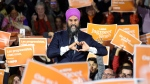 NDP leader Jagmeet Singh smiles as he makes a heart sign while attending a rally with supporters in Montreal on Wednesday, October 16, 2019. THE CANADIAN PRESS/Nathan Denette