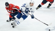 Washington Capitals left wing Brendan Leipsic (28) works for the puck against Toronto Maple Leafs center Auston Matthews (34) during the third period of an NHL hockey game Wednesday, Oct. 16, 2019, in Washington. The Capitals won 4-3. (AP Photo/Nick Wass)