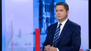 Conservative leader Andrew Scheer waits to participate in a televised interview in Toronto, Ont. Wednesday October 16, 2019. THE CANADIAN PRESS/POOL/Adrian Wyld