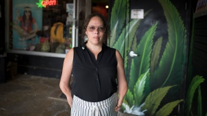 Owner Abi Roach poses for a photograph outside the Hotbox Cafe in Toronto's Kensington Market on Thursday, October 10, 2019. THE CANADIAN PRESS/Tijana Martin