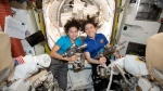 In this photo released by NASA on Thursday, Oct. 17, 2019, U.S. astronauts Jessica Meir, left, and Christina Koch pose for a photo in the International Space Station.  (NASA via AP)