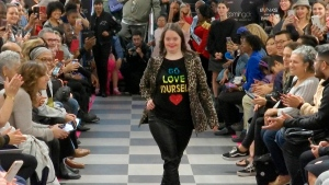 "This image from video taken on Wednesday, Oct. 16, 2019 shows a girl participating in the 2nd annual ""Gigi's Playhouse Fashion Show"" in New York. Gigi's Playhouse is an education and achievement center that prepares young people with Down syndrome to engage more fully in their homes, schools and communities. (AP Photo/Gary Gerard Hamilton)"