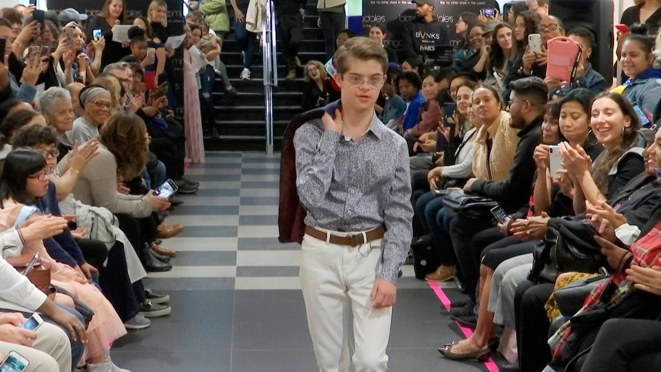 "This image from video taken on Wednesday, Oct. 16, 2019 shows a boy participating in the 2nd annual ""Gigi's Playhouse Fashion Show"" in New York. Gigi's Playhouse is an education and achievement center that prepares young people with Down syndrome to engage more fully in their homes, schools and communities. (AP Photo/Gary Gerard Hamilton)"