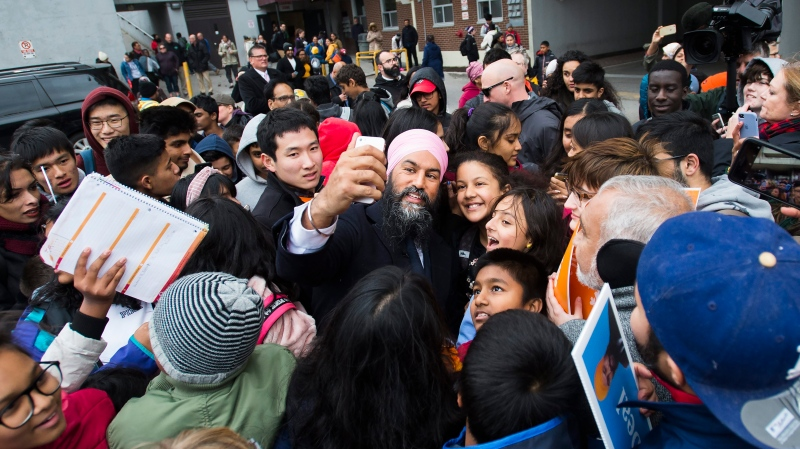 NDP leader Jagmeet Singh greets supporters and children in Toronto on Thursday, October 17, 2019. THE CANADIAN PRESS/Nathan Denette