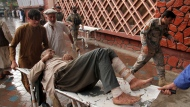A wounded man is brought by stretcher into a hospital after a mortar was fired by insurgents in Haskamena district of Jalalabad east of Kabul, Afghanistan, Friday, Oct. 18, 2019. An Afghan official says at least several people have been killed during Friday prayers when a mortar fired by insurgents blasted through the roof of a mosque. (AP Photo/Wali Sabawoon)