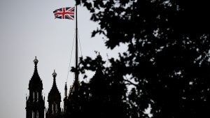 The Union Flag flies over the Victoria Tower, Houses of Parliament, in London, Friday, Oct. 18, 2019. Britain's Parliament is set to vote Saturday on Prime Minister Boris Johnson's new deal with the European Union, a decisive moment in the prolonged bid to end the Brexit stalemate. Various scenarios may be put in motion by the vote. (AP Photo/Alberto Pezzali)