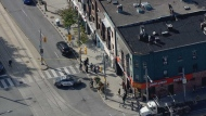 Toronto police have blocked a portion of St. Clair Avenue West at Oakwood Avenue after a shooting left a man injured. (CP24)