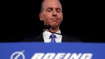 FILE - In this April 29, 2019 file photo, Boeing Chief Executive Dennis Muilenburg speaks during a news conference. Boeing was aware of troubling instant messages between two employees regarding their communications with federal regulators over its now-grounded 737 Max jet, but the company waited months to disclose them. (AP Photo/Jim Young, Pool)