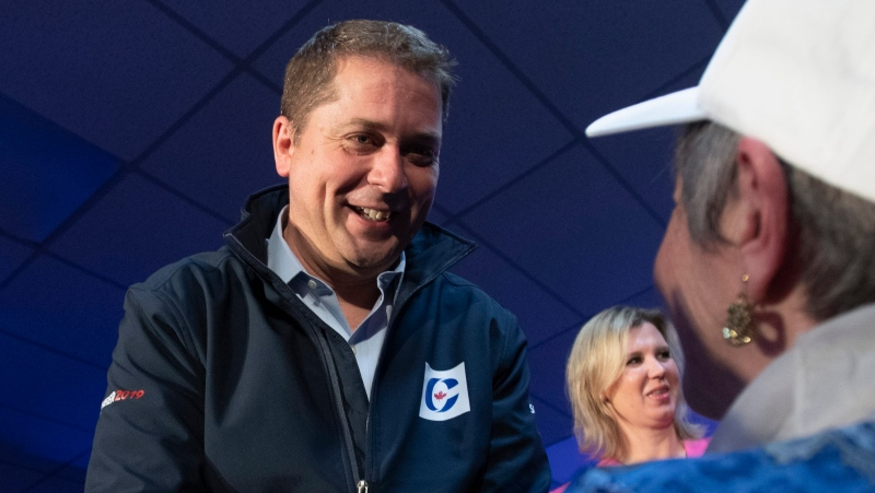 Conservative leader Andrew Scheer listens to a question during a campaign stop in Fredericton, Friday, October 18, 2019. THE CANADIAN PRESS/Adrian Wyld