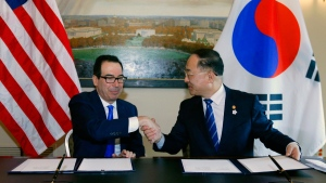 Secretary of the Treasury Steven Mnuchin shake hands with South Korean Deputy Prime Minister and Finance Minister Hong Nam-ki after a signing ceremony of U.S.- Republic of Korea Framework to Strengthen Infrastructure Finance and Market Building Cooperation, at Treasury Department in Washington, Thursday, Oct. 17, 2019. (AP Photo/Jose Luis Magana)