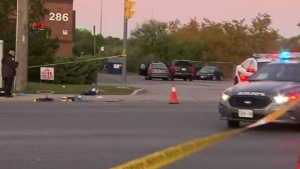 Police observe the scene where a man was shot in Etobicoke on Oct. 19, 2019. (CP24)