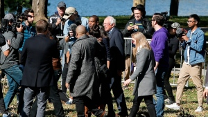 Democratic presidential candidate Sen. Bernie Sanders, I-Vt., (C) arrives to attend a rally on Saturday, Oct. 19, 2019 in New York. (AP Photo/Eduardo Munoz Alvarez)