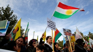 Protesters take part of a demonstration against Turkey's offensive in northern Syria, on Republique plaza in eastern Paris, Saturday, Oct. 19, 2019. (AP Photo/Thibault Camus)