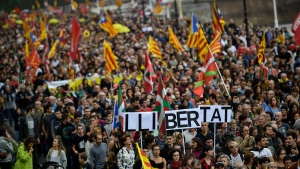 Thousands pro-independence basques activist march in a rally in support of Catalonia's independence movement following Spain's conviction of Catalan separatist leaders and calling their freedom, in San Sebastian, northern Spain, Saturday, Oct. 19, 2019. (AP Photo/Alvaro Barrientos)