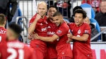 Toronto FC midfielder Marco Delgado (8) celebrates his goal with teammates, from left to right, Michael Bradley (4), Auro (96) and Tsubasa Endoh (31) during first half MLS playoff soccer action against the D.C. United, in Toronto on Saturday, Oct. 19, 2019. THE CANADIAN PRESS/Frank Gunn