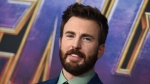 "FILE - In this April 22, 2019 file photo, Chris Evans arrives at the premiere of ""Avengers: Endgame"" at the Los Angeles Convention Center. The ""Captain America"" actor returned to his native Massachusetts to help dedicate the new home of a youth theater company where as a youngster he honed his acting skills. Evans helped cut the ribbon Saturday, Oct. 19 at the Concord Youth Theatre's permanent home. Evans, who grew up in nearby Sudbury, acted in Concord Youth Theatre productions starting when he was 9 years old. His mother, Lisa Evans, is the theater's director. (Photo by Jordan Strauss/Invision/AP, File)"