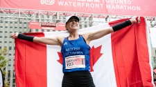 Dayna Pidhoresky celebrates after finishing the 2019 Scotiabank Toronto Waterfront Marathon as the top Canadian woman, in Toronto, on Sunday, Oct., 20, 2019. THE CANADIAN PRESS/Christopher Katsarov