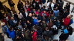 NDP leader Jagmeet Singh is swarmed by people in a mall during a campaign stop in Surrey, B.C., on Sunday, October 20, 2019. THE CANADIAN PRESS/Nathan Denette