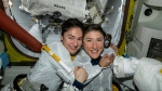 In this photo released by NASA on Friday, Oct. 18, 2019, U.S. astronauts Jessica Meir, left, and Christina Koch pose for a photo in the International Space Station. The astronauts who took part in the first all-female spacewalk are still uplifted by all the excitement down on Earth. (NASA via AP)