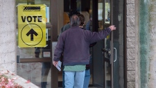 Voters head to cast their ballot in Canada's federal election at the Fairbanks Interpretation Centre in Dartmouth, N.S., Monday, Oct. 21, 2019. THE CANADIAN PRESS/Andrew Vaughan