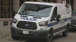 A police forensics van is seen on Four Springs Avenue in Mississauga after a woman was found dead and a toddler was located with serious injuries on Oct. 21, 2019. (CP24)