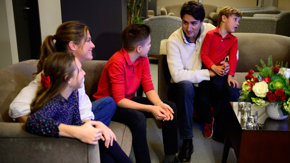 Liberal leader Justin Trudeau and wife Sophie Gregoire-Trudeau, and children Xavier, Ella-Grace and Hadrien watch election results in Montreal on Monday Oct. 21, 2019. THE CANADIAN PRESS/Sean Kilpatrick