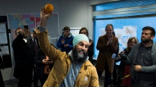 NDP Leader Jagmeet Singh hoists an orange after thanking his staff at his campaign office in Burnaby, B.C., on Monday, Oct. 21, 2019. THE CANADIAN PRESS/Nathan Denette