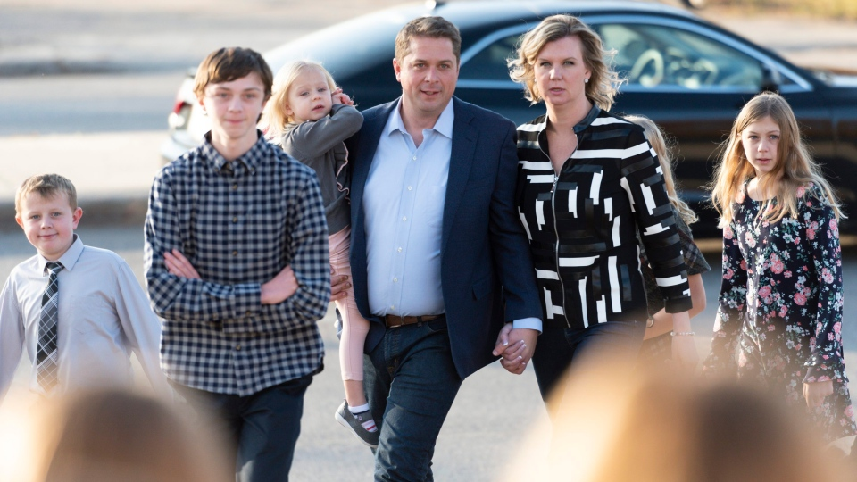 Conservative Party Leader Andrew Scheer, his wife Jill, and their children arrive to a voting station at Our Lady of Peace Parish on Election Day in Regina on Monday October 21, 2019. THE CANADIAN PRESS/Michael Bell