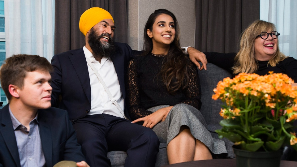 NDP Leader Jagmeet Singh. second left, and his wife Gurkiran Kaur, second right, watch the Canadian election results come in at his hotel room in Burnaby, B.C., on Monday, October 21, 2019. THE CANADIAN PRESS/Nathan Denette