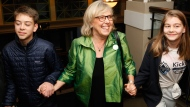 Green Party leader Elizabeth May arrives with her grandkids Moss Burton, 13 and his sister Nina Liv, 12, during election night as results come in at Crystal Gardens in Victoria, B.C., on Monday, October 21, 2019. THE CANADIAN PRESS/Chad Hipolito