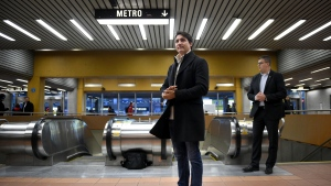 Prime Minister Justin Trudeau waits to greet commuters at a metro station in Montreal, Tuesday, Oct. 22, 2019. THE CANADIAN PRESS/Sean Kilpatrick