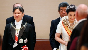 Japan's Emperor Naruhito, left, and Empress Masako, right, host the court banquet, in Tokyo, Tuesday, Oct. 22, 2019. Japan's Naruhito proclaimed himself Emperor during an enthronement ceremony at the Imperial Palace, declaring himself the country's 126th monarch.(Hiroko Harima/Kyodo News via AP)
