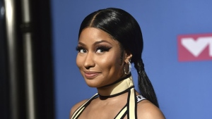 FILE - This Aug. 20, 2018 file photo shows Nicki Minaj at the MTV Video Music Awards in New York. Minaj, who has dated Kenneth Petty for about a year, seemed to confirm her marriage with a video on Instagram on Monday that showed off Mr. and Mrs. coffee mugs and bride and groom hats. The rapper also changed her Twitter name to Mrs. Petty. (Photo by Evan Agostini/Invision/AP, File)