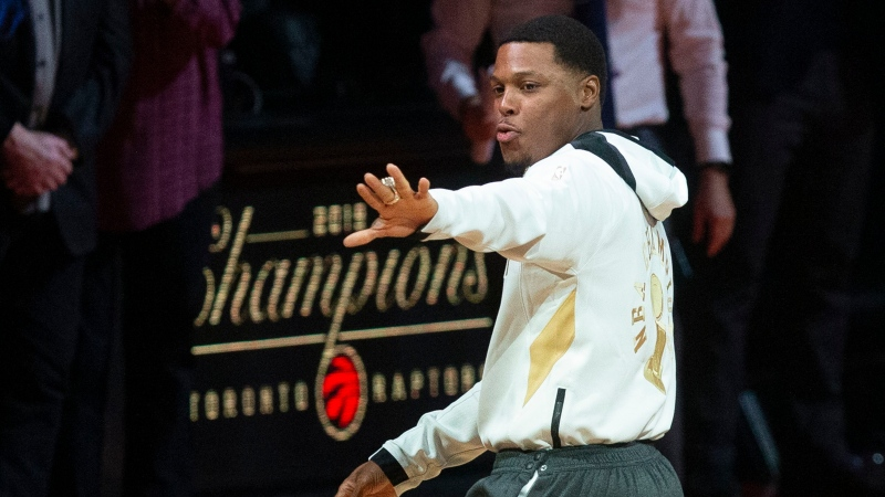 Toronto Raptors' Kyle Lowry looks at his Championship ring during a ceremony to celebrate their 2019 NBA Championship ahead of their NBA home opener against New Orleans Pelicans in Toronto on Tuesday October 22, 2019. THE CANADIAN PRESS/Chris Young