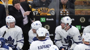 Toronto Maple Leafs coach Mike Babcock points as he talks with his players during a timeout in the third period of the team's NHL hockey game against the Boston Bruins in Boston, Tuesday, Oct. 22, 2019. (AP Photo/Charles Krupa)