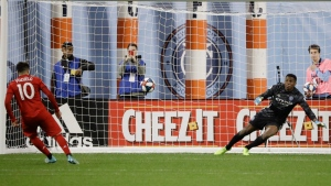Toronto FC's Alejandro Pozuelo (10) kicks the ball past New York City goalkeeper Sean Johnson for a goal on a penalty kick during the second half of an MLS Eastern Conference semifinal soccer match Wednesday, Oct. 23, 2019, in New York. Toronto won 2-1. (AP Photo/Frank Franklin II)