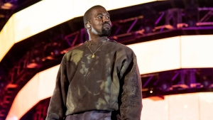 "FILE - This April 20, 2019 file photo shows Kanye West performing at the Coachella Music & Arts Festival in Indio, Calif. West has unveiled his ""Jesus Is King"" IMAX film featuring a gospel choir performing at artist James Turrell's dramatic Roden Crater in the Arizona desert. West showed the 35-minute film off to fans at an event Wednesday night at The Forum in Inglewood, Calif. (Photo by Amy Harris/Invision/AP, File)"