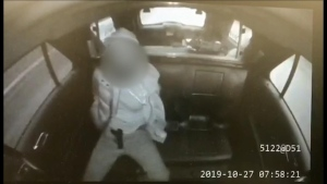 In a video obtained by CTV News Toronto, a handcuffed suspect appears to pull a handgun out of his pants while seated in the back of a police cruiser.