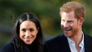 In this Dec. 1, 2017 file photo, Prince Harry and his fiancee Meghan Markle arrive at Nottingham Academy in Nottingham, England. (AP Photo/Frank Augstein)