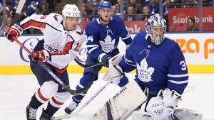 Washington Capitals left wing Jakub Vrana (13) looks for a rebound against Toronto Maple Leafs goaltender Frederik Andersen (31) as defenceman Tyson Barrie (94) looks on during first period NHL hockey action in Toronto on Tuesday, Oct. 29, 2019. THE CANADIAN PRESS/Hans Deryk