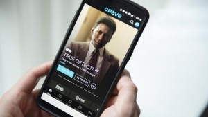 The Crave app is seen on a phone in Toronto on Thursday, February 7, 2019. Bell Media says it's struck an agreement with Warner Bros. to acquire the exclusive Canadian rights for original TV shows made for upcoming U.S. streaming service HBO Max. THE CANADIAN PRESS/Graeme Roy