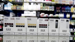 Picture above shows Juul packaging. A former Juul Labs executive is alleging that the vaping company knowingly shipped 1 million tainted nicotine pods to customers. Julio Cortez / AP