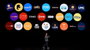 FILE - In this March 25, 2019, file photo Peter Stern, Apple Vice President of Services, speaks at the Steve Jobs Theater during an event to announce new products in Cupertino, Calif. Apple TV Plus launches on Friday for $5 a month with just eight shows and a few more coming soon. (AP Photo/Tony Avelar, File)