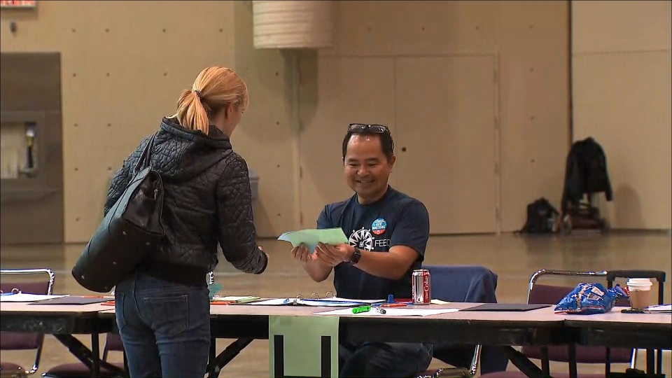 A teacher submits their vote in the October strike vote in Toronto on Oct. 30, 2019. (CP24)